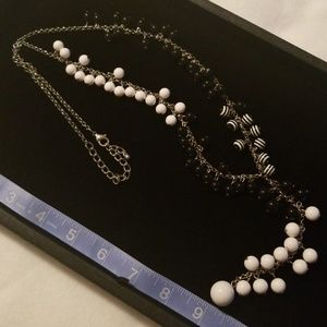 Silver long necklace w/white & black beads